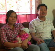 video - A couple with their baby at home