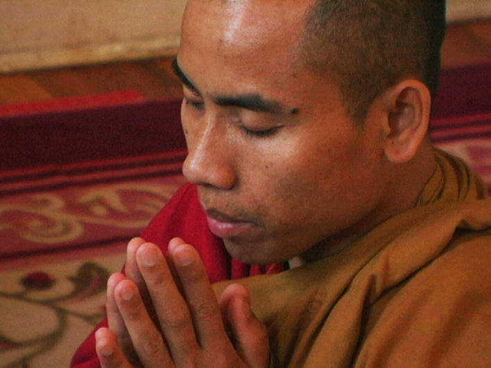 Man from Burma at home praying