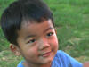 Young boy from Burma smiling at the camera