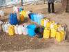 Water storage in camp where Darfuris live in Chad