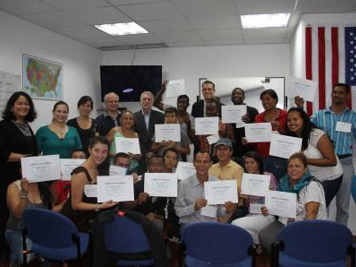 Smiling participants, trainers, and special guests at conclusion of session in Quito, Ecuador